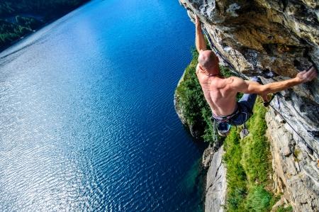 adrenalin: Climber climbing a rock wall above Lake Devero, Northern Italy