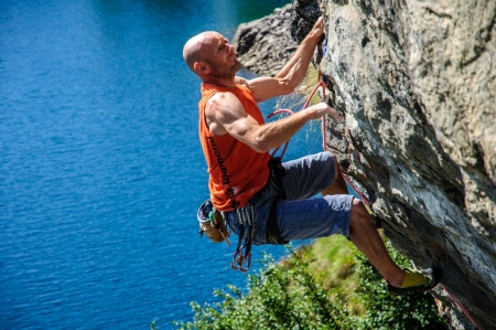 talcum: Climber climbing a rock wall above Lake Devero, Northern Italy
