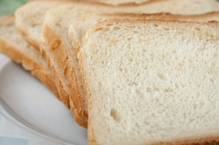 Some slices of toast bread on a white plate Stock Photo