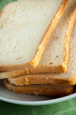 Slices of toast bread on a white plate