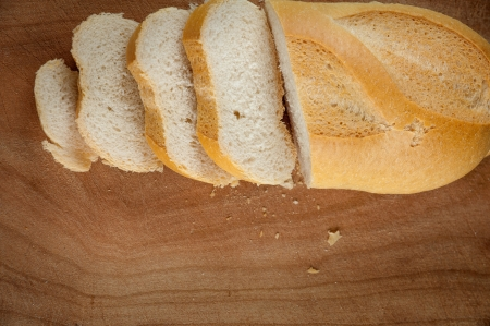 Slices of bread on a wooden chopping board