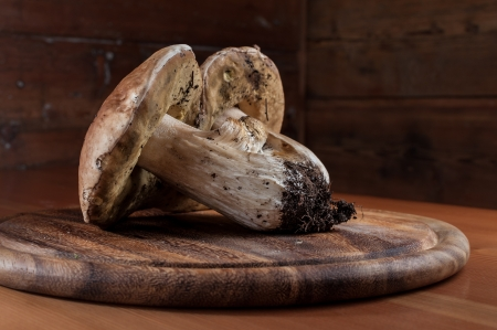 Porcini mushrooms on a wooden cutting board
