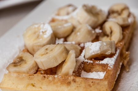 Brussels waffle with banana and sugar Stock Photo