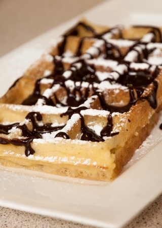 powdered sugar: Brussels waffle with chocolate and powdered sugar Stock Photo
