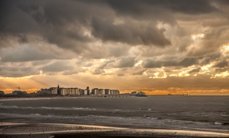 Apocalyptic atmosphere at sunset on a Belgian town overlooking the North Sea