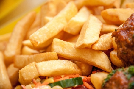 Mixed salad with chips and sauces