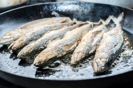 Fillet of mackerel fried in restaurant kitchen Stock Photo