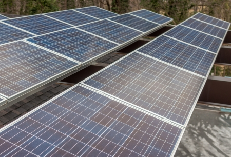 Solar panels in a industrial photovoltaic system installed on the roof of a shed Stock Photo