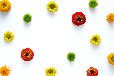 Spring arrangement with colorful flowers on white background. Copy sapce.