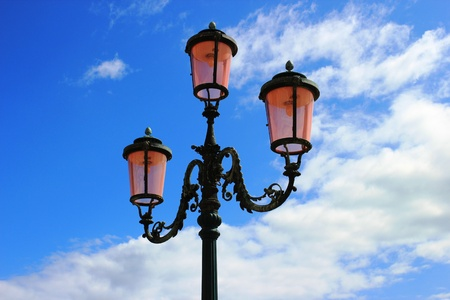 lantern in Venice in a day. Backgroud is beautifull blue sky with white clouds Stock Photo