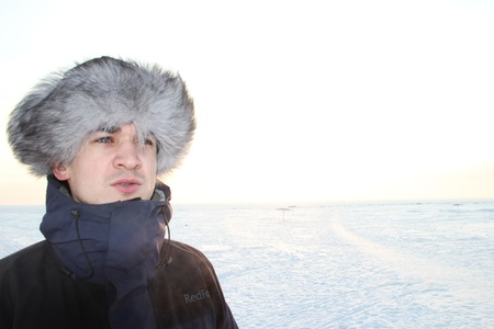 A portrait of man is in a fur cap Stock Photo - 12397891