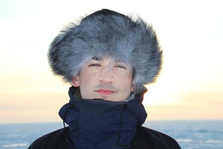 A portrait of man is in a fur cap photo