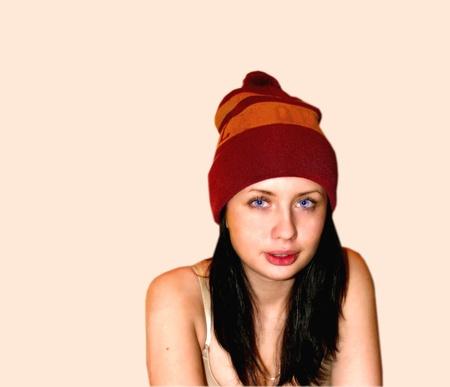 girl in a sports cap a piercing gaze