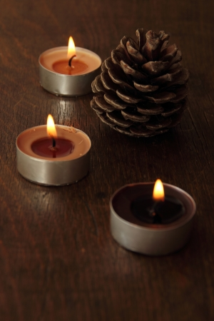 sacraments: Three candles and bumb in brown tones. Cinnamon and apple Stock Photo