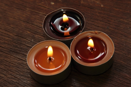 sacraments: Three candles in brown tones. Cinnamon and apple Stock Photo
