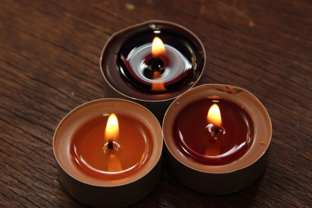 sacraments: Three candles in brown tones  Cinnamon and apple