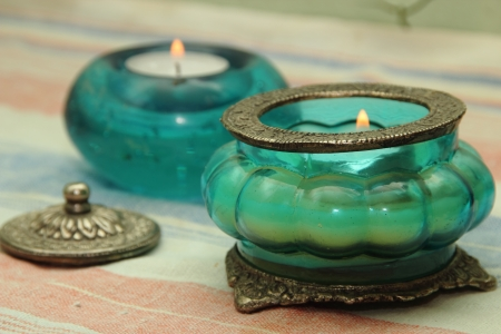 Beautiful vase, candle in oriental style  Blue and green tint Stock Photo
