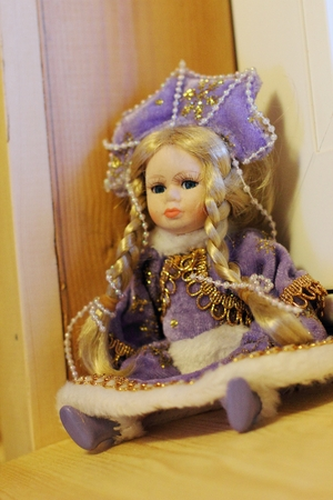 Doll in purple dress