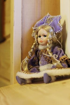 Doll in purple dress