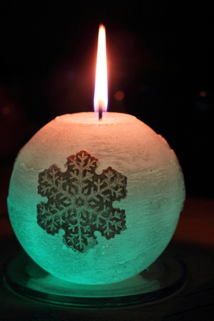 Glowing candle with a diode and snowflake Stock Photo