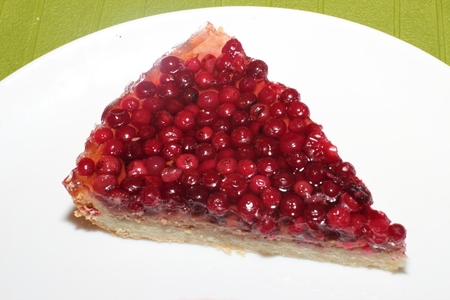 shortcake: Piece of cake with cranberries on a shortcake dough Stock Photo