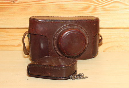Vintage camera in brown leather cover. Retro