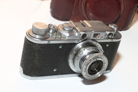 black and metal isolated vintage camera in retro style. Stock Photo