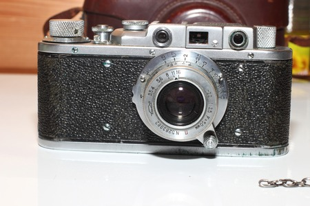 black and metal vintage camera in retro style.