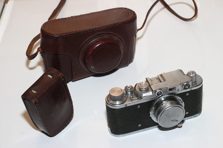 Isolated vintage camera,light meter and leather cover photo