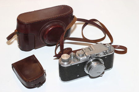 Isolated vintage camera,light meter and leather cover Stock Photo