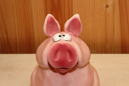 glass pig, piggy bank on a wooden background