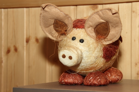 Decorative straw pig in a wooden house