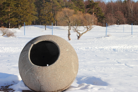 wastebasket: Winter landscape on the beach of Gulf of Finland with a concrete sculpture Stock Photo
