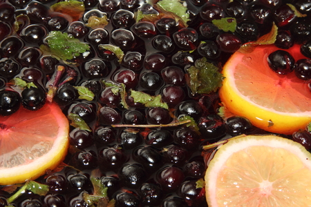 compote: chernoplodki compote with lemon and mint in cooking