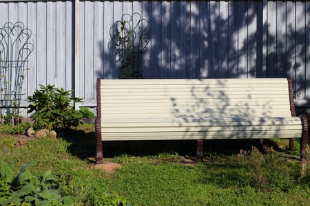 Bench in retro style in the summer garden Stock Photo