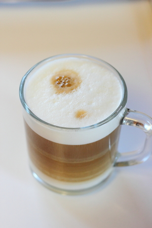 skim: Cappuccino in a transparent bowl on a white background