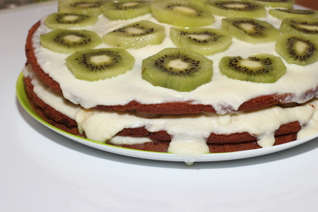Beautiful cake with kiwi and bananas on the table. Tea Party