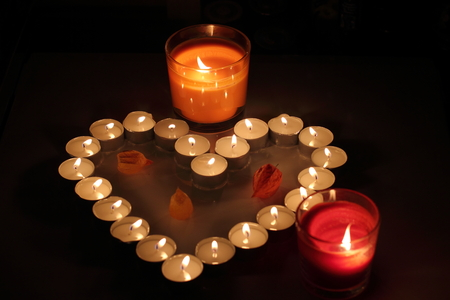 Heart of candles, a sign of love. romantic evening