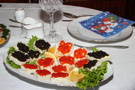 Sandwiches with red and black caviar on a celebratory table