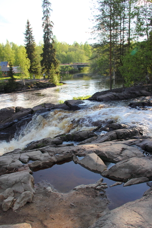 dawns: Waterfall in the Republic of Karelia, Russia. Northern nature