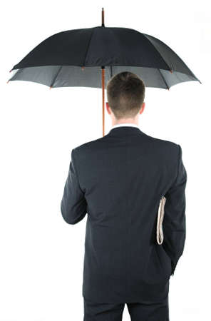 Businessman with an umbrella and a newspaper photo
