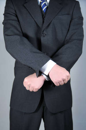 Businessman with hands crossed photo