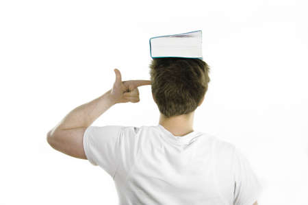 university choice: Young man with a book on his head
