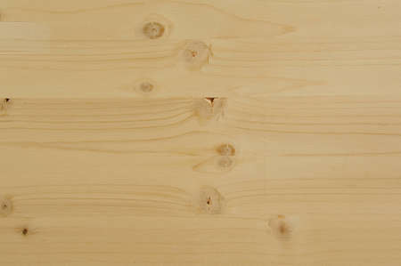 Tileable rough wood surface background. Yellow tone. photo