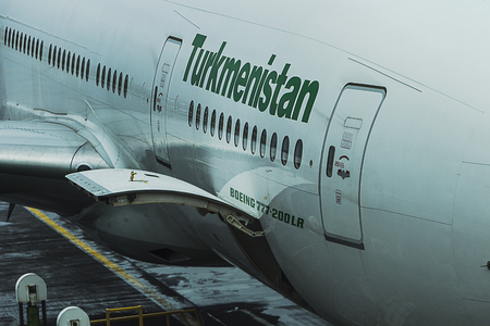 Yesilkoy, Istanbul / Turkey November 28th, 2018: Turkmenistan Airlines Boeing 777-200LR, a long range aircraft has docked at an international gate at Istanbul Ataturk Airport on a rainy day.