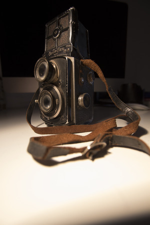 Istanbul, Turkey  January 26, 2019: Portrait of a 1930s dual lens Rolleiflex camera made in Germany, heavily used and battered.