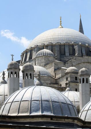 Detail of domes and chimneys of the Suleymaniye Mosque in a sunny day under blue sky. Stok Fotoğraf