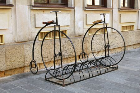 Two 19th century bicycles decorating a contemporary bicycle park is vandalized.