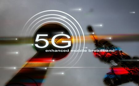 5G enhanced mobile broadband technology concept with broadband antenna and radar tower. Low angle view looking at the sky. Stock fotó
