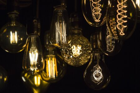 Retro electric bulbs together illuminating the dark.
